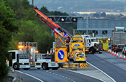 © Licensed to London News Pictures. 13/08/2018<br /> SWANLEY, UK.<br /> Recovery operation now in progress,  it could take hours.<br /> Coach overturns on the M25 Slip road junction 3 for Swanley.<br /> Photo credit: Grant Falvey/LNP