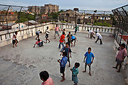 Children play football on the roof of the CINI halfway house in Calcutta, India..Child In Need Institute (CINI) run halfway houses for vulnerable street children from as young as 5 years old with the aim of reconnecting the children with their families.