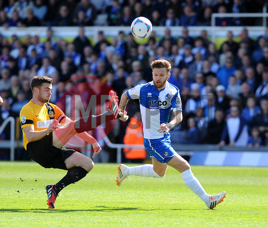 Southport's Luke George clears from Bristol Rovers' Matty Taylor - Photo mandatory by-line: Neil Brookman/JMP - Mobile: 07966 386802 - 11/04/2015 - SPORT - Football - Bristol - Memorial Stadium - Bristol Rovers v Southport - Vanarama Football Conference