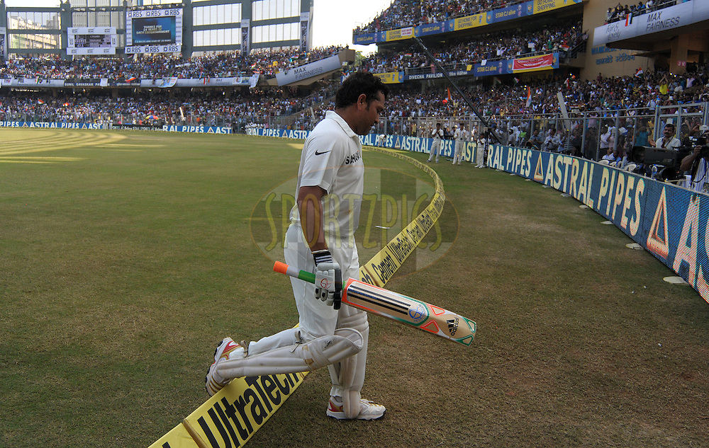 Sachin Tendulkar of India acknowledges the crowd as he walks back after getting out  during day two of the second Star Sports test match between India and The West Indies held at The Wankhede Stadium in Mumbai, India on the 15th November 2013<br /> <br /> This test match is the 200th test match for Sachin Tendulkar and his last for India.  After a career spanning more than 24yrs Sachin is retiring from cricket and this test match is his last appearance on the field of play.<br /> <br /> <br /> Photo by: Pal PIllai - BCCI - SPORTZPICS<br /> <br /> Use of this image is subject to the terms and conditions as outlined by the BCCI. These terms can be found by following this link:<br /> <br /> http://sportzpics.photoshelter.com/gallery/BCCI-Image-Terms/G0000ahUVIIEBQ84/C0000whs75.ajndY