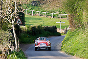 MG sports car convertible travelling on winding country road, Swinbrook, Oxfordshire, The Cotswolds, England, United Kingdom