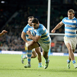 Jeronimo de la Fuente of Argentina beats Michael Hooper (left) and Scott Sio (1) of Australia to score his team's 2nd Try during the The Rugby Championship match between Argentina and Australia at Twickenham Stadium, Twickenham - 08/10/2016<br />