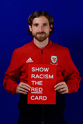 CARDIFF, WALES - Tuesday, October 9, 2018: Wales' Joe Allen holds a Show Racism The Red Card sign during a media session at the St Fagans National Museum of History ahead of the International Friendly match between Wales and Spain. (Pic by David Rawcliffe/Propaganda)