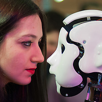 Lyon, France - 19 March 2014: a woman looks at Jane by France Robotique at Innorobo 2014, the biggest fair in Europe for robotics.