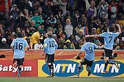 ©Jonathan Moscrop - LaPresse<br /> 02 07 2010 Johannesburg ( Sud Africa )<br /> Sport Calcio<br /> Uruguay vs Ghana - Mondiali di calcio Sud Africa 2010 Quarti di finale - Soccer City Johannesburg<br /> Nella foto: esultanza dell'Uruguay dopo la rete del 1-1 di Diego Forlan<br /> <br /> ©Jonathan Moscrop - LaPresse<br /> 02 07 2010 Johannesburg ( South Africa )<br /> Sport Soccer<br /> Uruguay versus Ghana - FIFA 2010 World Cup South Africa Quarter final - Soccer City Stadium<br /> In the Photo: Uruguay players celebrate after Diego Forlan's goal levelled the scores at 1-1