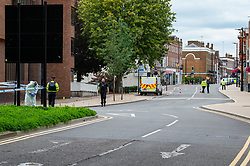 © Licensed to London News Pictures. 07/09/2020. High Wycombe, UK. Police officers and a forensic investigator in High Wycombe after reports of a stabbing on Easton Street, a large cordon is centred around the High Wycombe Magistrates Court. Photo credit: Peter Manning/LNP