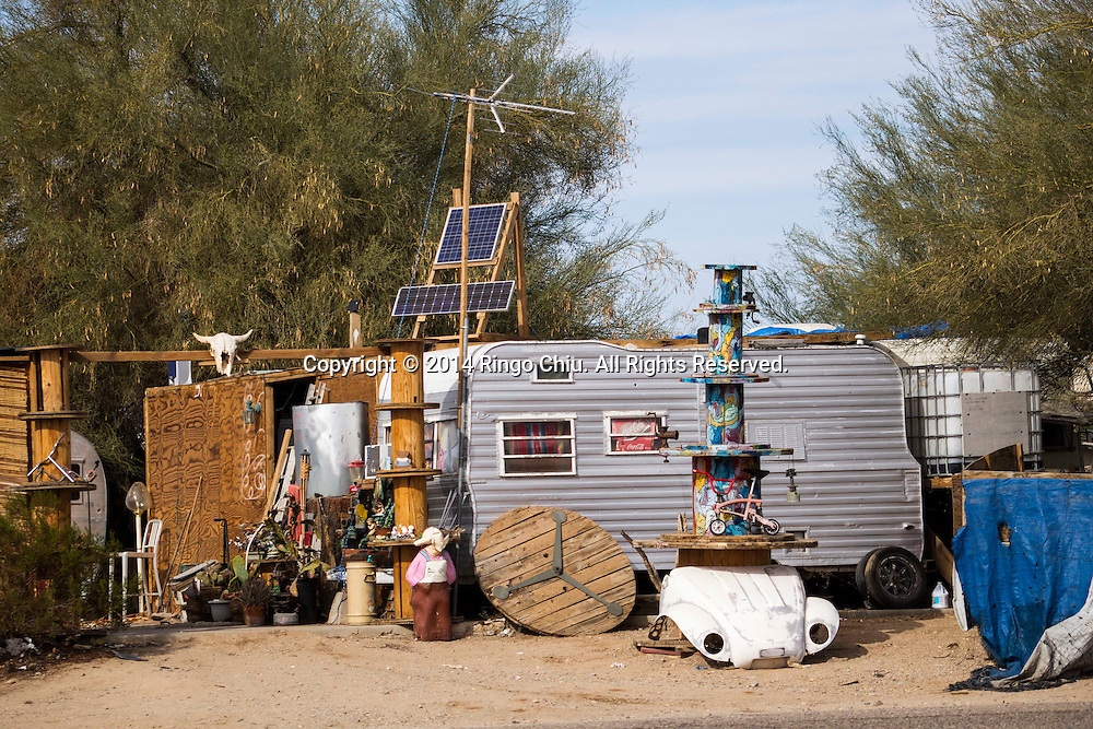 A mobile home is seen on  January 4, 2014, in Slab City, California. Slab City or The Slabs is a snowbird campsite in the Colorado Desert in southeastern California, used by recreational vehicle owners and squatters from across North America. It takes its name from the concrete slabs that remain from the abandoned World War II Marine barracks of Camp Dunlap. (Photo by Ringo Chiu/PHOTOFORMULA.com)