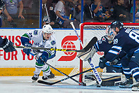 PENTICTON, CANADA - SEPTEMBER 8: Jakob Stukel #34 of Vancouver Canucks attempts a wrap around goal on Mikhail Berdin #80 of the Winnipeg Jets on September 8, 2017 at the South Okanagan Event Centre in Penticton, British Columbia, Canada.  (Photo by Marissa Baecker/Shoot the Breeze)  *** Local Caption ***