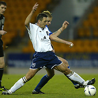 St Johnstone v Ross County....06.12.03<br />David Hannah battles with Ryan Stevenson<br /><br />Picture by Graeme Hart.<br />Copyright Perthshire Picture Agency<br />Tel: 01738 623350  Mobile: 07990 594431