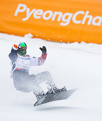 March 16, 2018 - Pyeongchang, South Korea - Mike Minor of the US celebrates his gold medal finish in the Snowboard Banked Slalom event Friday at Jeongseon Alpine Center at the Pyeongchang Winter Paralympic Games. (Credit Image: © Mark Reis via ZUMA Wire)