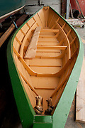 A nearly finished dory at The Dory Shop, Gloucester, MA Hand made of white pine and red oak.