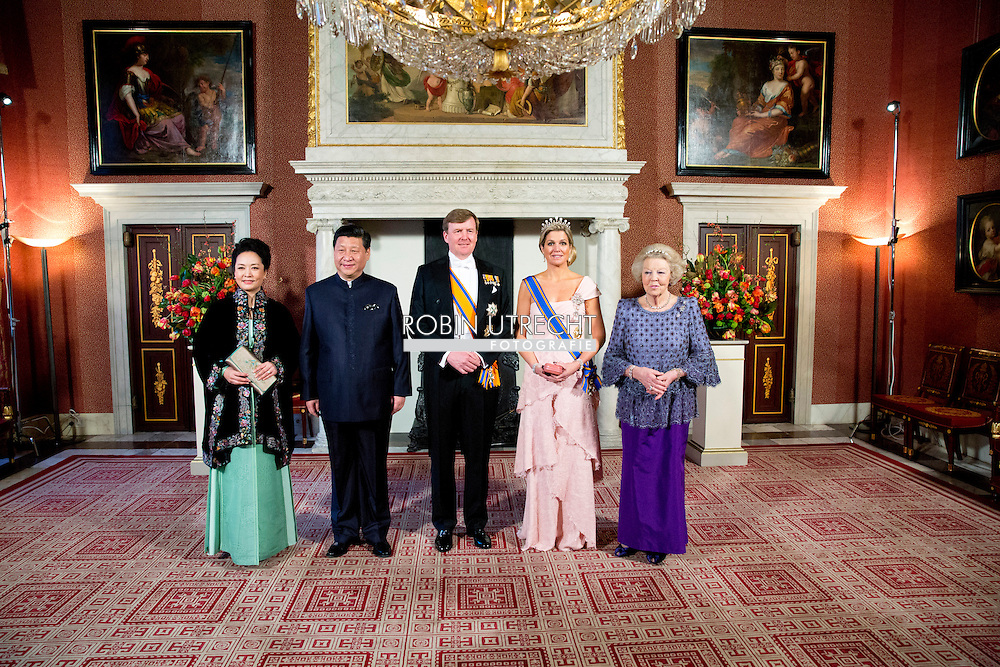 AMSTERDAM King Willem-Alexander, Queen Maxima and Princess Beatrix pose with Chinese President Xi Jinping and his wife Peng Liyuan before the state banquet at the Royal palace Amsterdam, The Netherlands, 22 March 2014. The Chinese president is in The Netherlands for a two day state visit before the NSS summit in The Hague. COPYRIGHT ROBIN UTRECHT