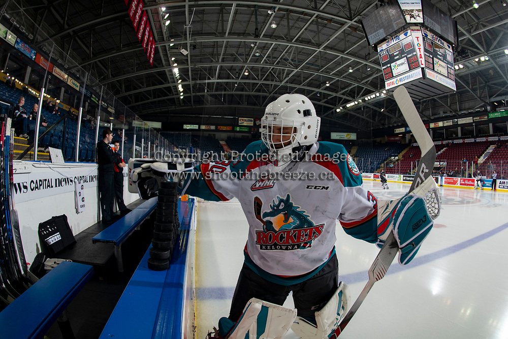 KELOWNA, CANADA - FEBRUARY 16:  Roman Basran #30 of the Kelowna Rockets throws pucks to the ice at the start of warm up against the Vancouver Giants on February 16, 2019 at Prospera Place in Kelowna, British Columbia, Canada.  (Photo by Marissa Baecker/Shoot the Breeze)
