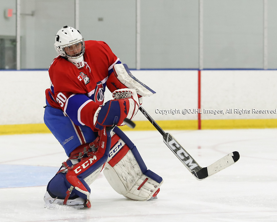 TORONTO, ON - Oct 10, 2015 : Ontario Junior Hockey League game action between North York and Toronto.<br /> Goaltender, Daniel Lopapa #30 of the Toronto Jr Canadiens, clears the puck during the third period. <br /> (Photo by Anna Matthews / OJHL Images)