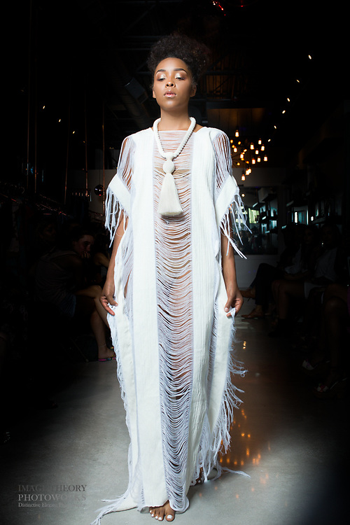 Photo of Houston fashion model Esmaralda Rojas walks runway in white kaftan for Houston Fashion Week, by Gerard Harrison.