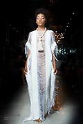 Photo of Houston fashion model Esmaralda Rojas walks runway in white kaftan for Houston Fashion Week, by Gerard Harrison.