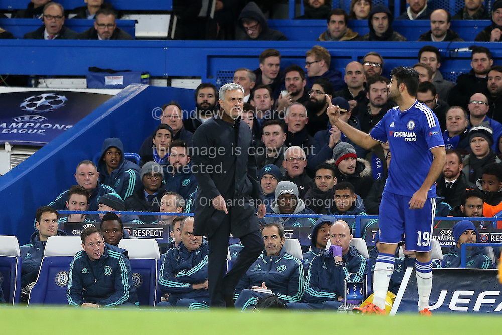 Jose Mourinho, the Chelsea Manager  (l) and Diego Costa of Chelsea have words during the 1st half as Costa gestures. UEFA Champions league group G match, Chelsea v Porto at Stamford Bridge in London on Wednesday 9th December 2015.<br /> pic by John Patrick Fletcher, Andrew Orchard sports photography.