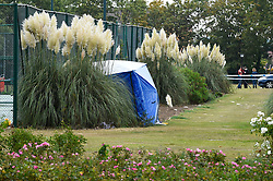 © Licensed to London News Pictures. 22/09/2019. SLOUGH, UK.  One of two forensics tents is seen next to a tennis court at Salt Hill Park in Slough, Berkshire, where it is reported a 15 year old boy was fatally stabbed after an altercation with another male.  Emergency services attended the scene at 6.30pm on the evening of 21 September where the boy was pronounced dead.  Investigations are ongoing.  Photo credit: Stephen Chung/LNP