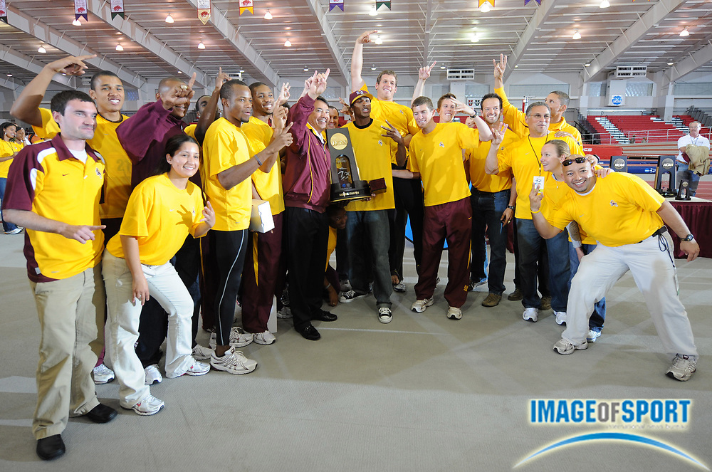 Mar 15, 2008; Fayetteville, AR, USA; The Arizona men and coach Greg Kraft pose with championship plaque after winning the team title in the NCAA indoor track and field championships at the Randal Tyson Center.
