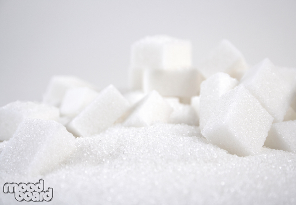Lump sugar on white background