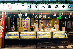 Traditional food shop on Nakamise Shopping Street at Sensoji Shrine in Asakusa district of Tokyo Japan