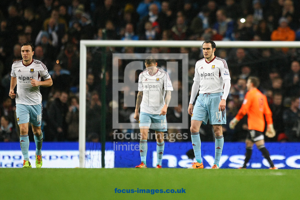 Picture by Paul Chesterton/Focus Images Ltd +44 7904 640267<br /> 08/01/2014<br /> The West Ham players look dejected after Alvaro Negredo of Man City scored his side's 4th goal during the Capital One Cup Semi Final 1st Leg match at the Etihad Stadium, Manchester.