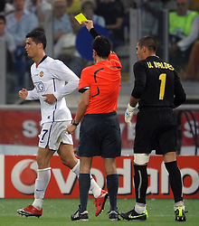 A dejected Cristiano Ronaldo, is given a yellow card during the final of the UEFA football Champions League on May 27, 2009 at the Olympic Stadium in Rome.