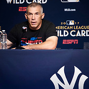 October 2, 2017 - New York, NY : New York Yankees manager Joe Girardi, wearing a Puerto Rico t-shirt in support of the victims of Hurricane Maria, fields questions during a press conference prior to a team workout at Yankee Stadium on the first day of the 2017 Major League Baseball post-season, Monday, Oct. 2.  The Bombers play the Minnesota Twins in a wildcard game tomorrow. CREDIT: Karsten Moran for The New York Times