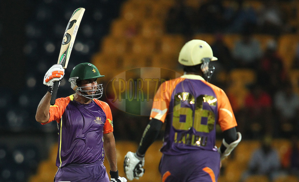 Nasir Jamshed of Ruhuna Royals raises his bat after reaching his fifty during match 17 of the Sri Lankan Premier League between Basnahira Cricket Dundee and Ruhuna Royals held at the Premadasa Stadium in Colombo, Sri Lanka on the 25th August 2012. .Photo by Shaun Roy/SPORTZPICS/SLPL