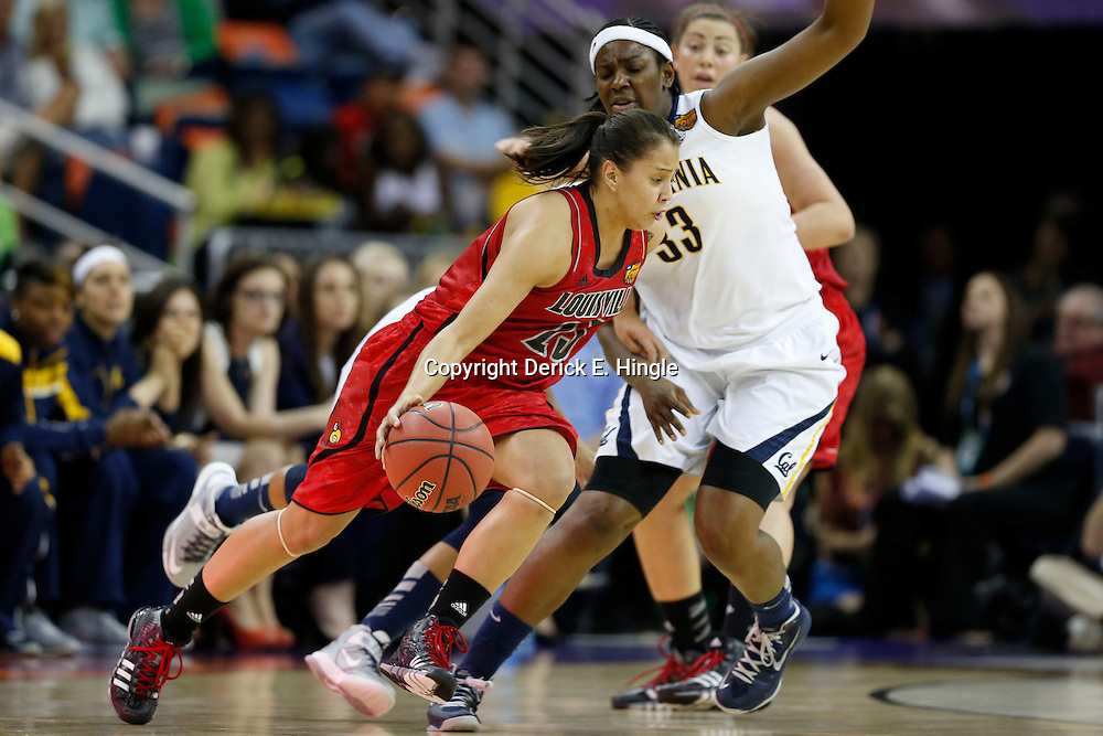 April 7, 2013; New Orleans, LA, USA; Louisville Cardinals guard Shoni Schimmel (23) dribbles against California Golden Bears center Talia Caldwell (33) during the first half in the semifinals during the 2013 NCAA womens Final Four at the New Orleans Arena. Mandatory Credit: Derick E. Hingle-USA TODAY Sports
