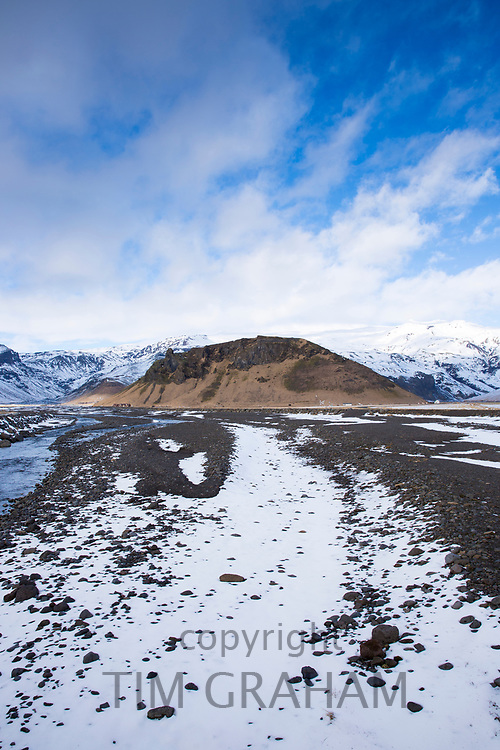 Dwellings and volcanic moraine under Eyjafjallajokull glacier famous for major volcanic eruption, Thorsmork Valley. Katla Geopark South Iceland