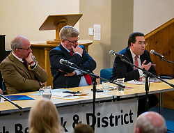 North Berwick, East Lothian, Scotland, United Kingdom, 28 November 2019. General Election: First hustings for the 5 candidates seeking election as MP for East Lothian with questions from the audience ranging from Defence to Honesty. Pictured (L to R): Robert O'Riordan, Scottish Liberal Democrats candidate, sitting MP Martin Whitfield, Scottish Labour Party candidate, Haddington and Lammermuir ward councillor Craig Hoy, Scottish Conservative & Unionist Party candidate<br /> Sally Anderson | EdinburghElitemedia.co.uk