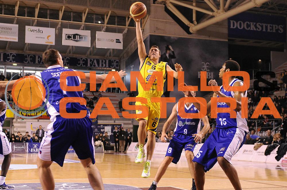 DESCRIZIONE : Ancona Lega A 2012-13 Sutor Montegranaro Chebolletta  Cantu<br /> GIOCATORE : Lorenzo Panzini<br /> CATEGORIA : tiro<br /> SQUADRA : Sutor Montegranaro<br /> EVENTO : Campionato Lega A 2012-2013 <br /> GARA : Sutor Montegranaro Chebolletta  Cantu<br /> DATA : 23/12/2012<br /> SPORT : Pallacanestro <br /> AUTORE : Agenzia Ciamillo-Castoria/C.De Massis<br /> Galleria : Lega Basket A 2012-2013  <br /> Fotonotizia : Ancona Lega A 2012-13 Sutor Montegranaro Chebolletta  Cantu<br /> Predefinita :