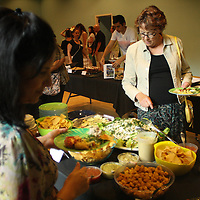 Marianne Abicht samples food during the Wilmington Vegan Dining Guide Release Celebration Sunday August 3, 2014. The event featured vegan doses by local restaurants and businesses and a silent auction. (Jason A. Frizzelle)