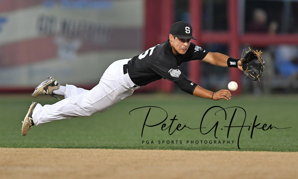Shortstop Jacob Prater #15 of the Seattle Studs dives for a ball hit up the middle in the fifth inning during the NBC World Series on August 6, 2016 at Lawrence-Dumont Stadium in Wichita, Kansas.