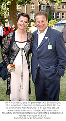 MR P Y GERBEAU and TV presenter KATE SANDERSON, at a reception in London on 16th June 2003.PKL 16