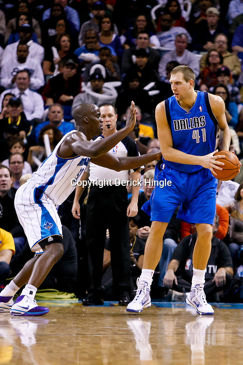 November 17, 2010; New Orleans, LA, USA; Dallas Mavericks power forward Dirk Nowitzki (41) of Germany is defended by New Orleans Hornets center Emeka Okafor (50) during a game at the New Orleans Arena. The Hornets defeated the Mavericks 99-97. Mandatory Credit: Derick E. Hingle