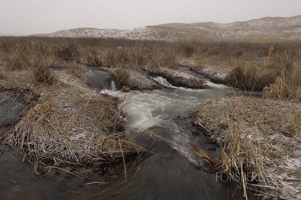 Nebraska Sandhills..Small waterfalls along Blue Creek in winter..Blue Creek stays open even in the deepest cold of winter, fed by powerful underground springs from the Ogallala aquifer below.