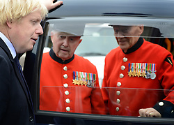 © Licensed to London News Pictures. 02/05/2012. London, UK Boris Johnston listens to a Chelsea Pensioners story through a cab window. London Mayor, Boris Johnson is joined by comedian Al Murray to wave off an army of WWII veterans who are embarking on an iconic trip to the Netherlands, via a convoy of black cabs. The London Taxi Benevolent Association for the War Disabled has organised a trip for 160 WWII veterans to travel to Holland in 80 London Black Cabs. The veterans, mostly aged between 85 and 94, will start their journey from London today 2nd May 2012 and will be visiting sites of importance from WWII and taking part in Dutch Liberation Day celebrations as guests of honour of the Dutch Royal Family.. Photo credit : Stephen Simpson/LNP