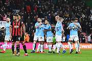 Riyad Mahrez (26) of Manchester City and his team mates hug at full time after a 1-0 win over Bournemouth during the Premier League match between Bournemouth and Manchester City at the Vitality Stadium, Bournemouth, England on 2 March 2019.