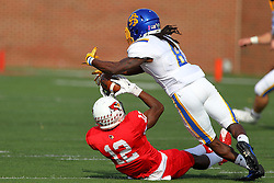 29 October 2016:  Christian Gibbs makes a reception as he falls backwards to the turf followed by Anthony Washington. NCAA FCS Football game between South Dakota State Jackrabbits and Illinois State Redbirds at Hancock Stadium in Normal IL (Photo by Alan Look)