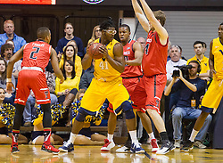 Mar 2, 2016; Morgantown, WV, USA; West Virginia Mountaineers forward Devin Williams (41) backs down Texas Tech Red Raiders forward Matthew Temple (34) during the first half at the WVU Coliseum. Mandatory Credit: Ben Queen-USA TODAY Sports