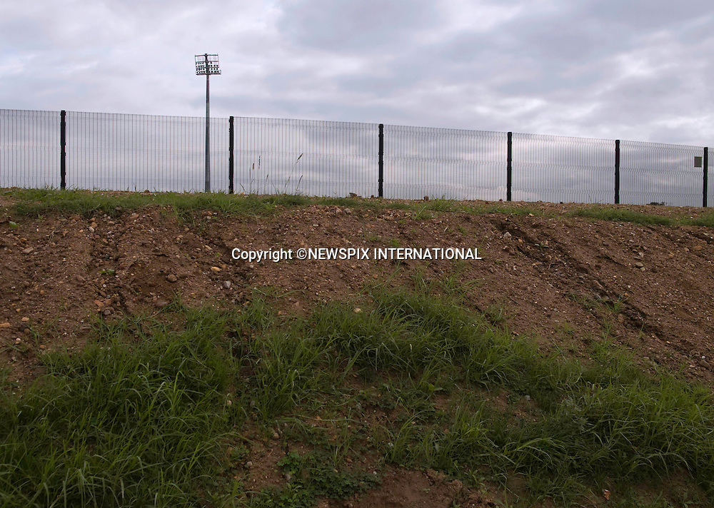 "EXCLUSIVE!! .Must telephone +441279 324672 for reproduction fees and usage..FORTIFIED WORLD CUP 2010 STADIUMS.To protect the visiting teams while training at the Gelvandale Stadium, Port Elizabeth, it has been fortified with and outer wall topped with barbed wire and inner fence on a raised 20ft mound..Crime and poverty are rife in the area bordering the football stadiums where the matches will be played..Teams and fans from England, Germany, Portugal, Cote d'Ivoire, Switzerland, Serbia, Slovenia, Chile, Korea and Greece will descend on the area during the World Cup 2010..Mandatory Credit Photos: ©Newspix International..**ALL FEES PAYABLE TO: ""NEWSPIX INTERNATIONAL""**..PHOTO CREDIT MANDATORY!!: NEWSPIX INTERNATIONAL(Failure to credit will incur a surcharge of 100% of reproduction fees)..IMMEDIATE CONFIRMATION OF USAGE REQUIRED:.Newspix International, 31 Chinnery Hill, Bishop's Stortford, ENGLAND CM23 3PS.Tel:+441279 324672  ; Fax: +441279656877.Mobile:  0777568 1153.e-mail: info@newspixinternational.co.uk"