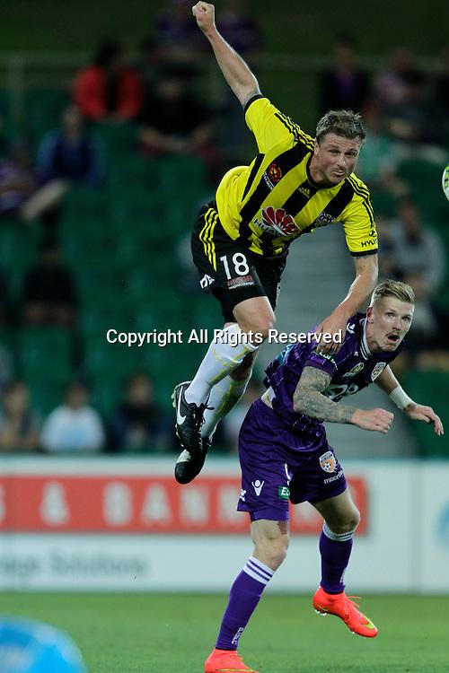 21.11.2014 Perth, Australia. Hyundai A League round 7, Perth Glory versus Wellington Phoenix. Benjamin Sigmund gets airborne.