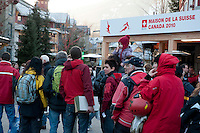 People line up outside the House of Switzerland in Whistler, BC for the opening on Feb 6, 2010