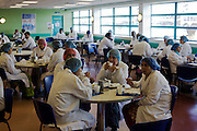Employees of the airline in-flight meals production company Gate Gourmet take brewak in company canteen at Heatrhrow Airport