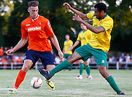 Gary Wharton of Hitchin Town (right) tackles Alex Wall of Luton Town (left) during the Pre Season Friendly match at Top Field, Hitchin<br /> Picture by David Horn/Focus Images Ltd +44 7545 970036<br /> 17/07/2014