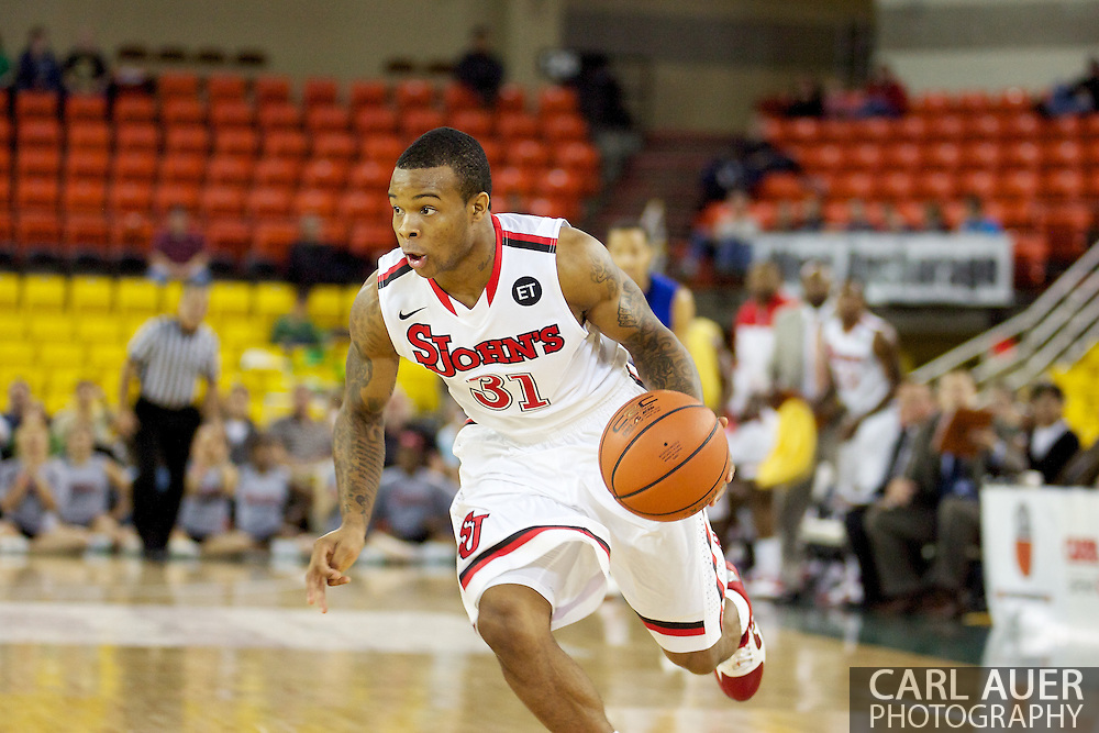 November 26th, 2010:  Anchorage, Alaska - St. John's sophomore guard Malik Stith (31) drives in the Red Storm's semi final game of the Great Alaska Shootout against the Drake Bulldogs.  The Red Storm defense held Drake to a tournament low score as St. Johns advanced to the final game 82-39.