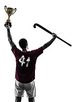 one caucasian field hockey player man isolated silhouette on white background