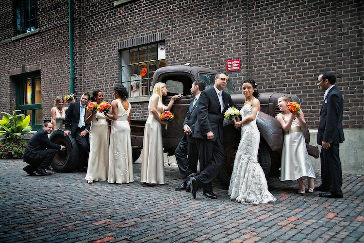 A bridal party enjoys a photo-scene arranged by their photographer at the Distillery District, Toronto. To view Myriam and Cory's complete Wedding Gallery Collection, please visit the Client Area and log-in. You'll be able to view these and other images as a slideshow, order prints and more.<br />